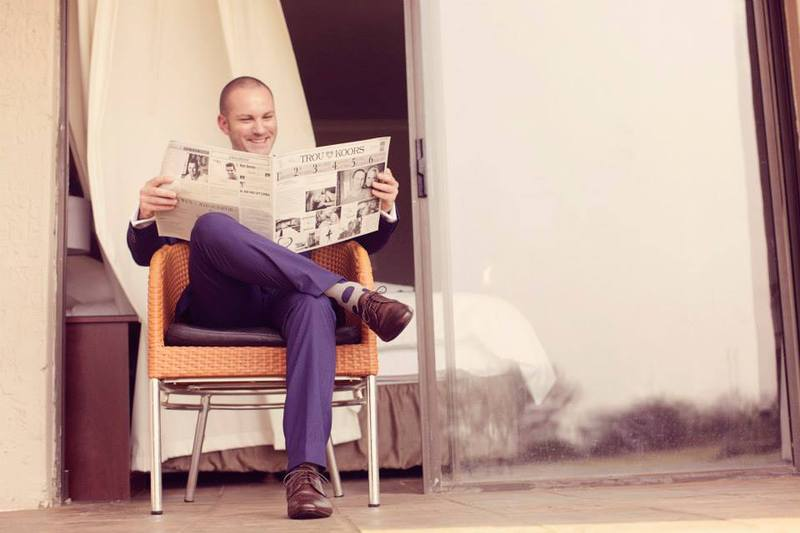 How bout that!!!!!!!!!  Even the groom is enjoying his wedding newspaper before the I do's!!!