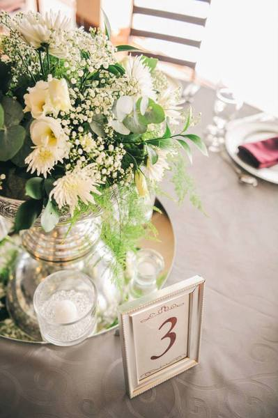 Great way to indicate the table numbers and also a fantastic way to recycle some picture frames.