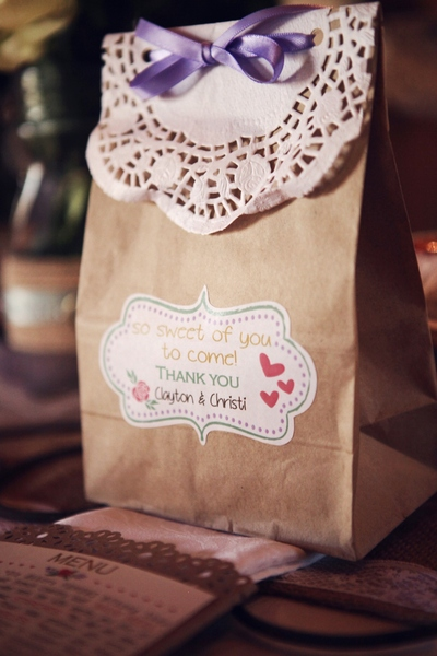 Awesome gift bags - made with brown paper bags with delicious home made goods on the inside. A personalized sticker on the outside thanking the guests.