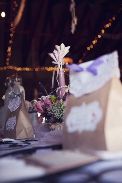 Gorgeous wedding table with favour bags and handmade origami flowers.