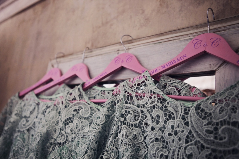 Bridesmaids dresses looking sooo pretty on their customized hangers.