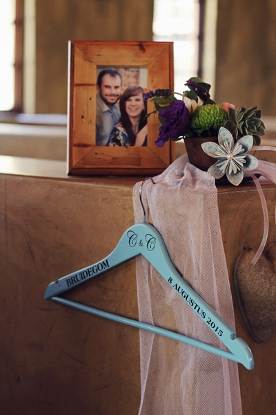 Customized hanger, with origami flowers and picture in a frame looking stunning in the church and adding to the rustic feel.
